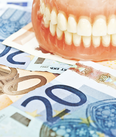 Denture on euros - dental expenses concept