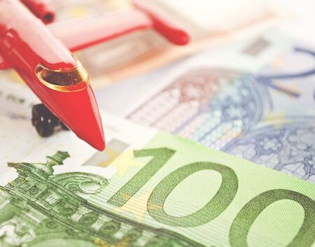 Close up view on airplane and euro bank notes - Travel with airplane concept