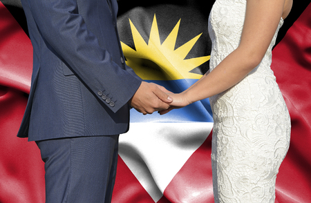 Husband and Wife holding hands - Conceptual photograph of marriage in Antigua and Barbuda