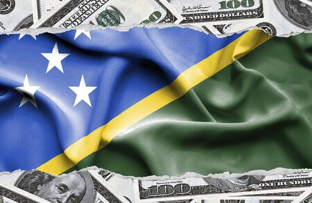 Financial concept with banknotes of US currency around national flag of Solomon Islands Stock Photo