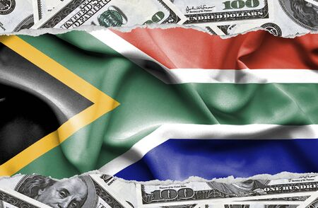 Financial concept with banknotes of US currency around national flag of South Africa
