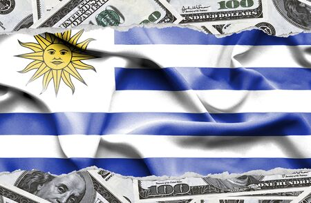 Financial concept with banknotes of US currency around national flag of Uruguay