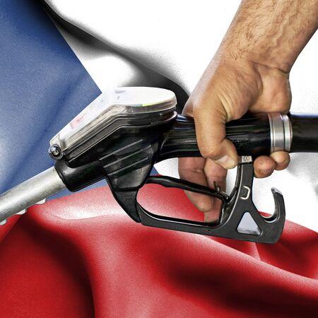 Gasoline consumption concept - Hand holding hose against flag of Czech Republic