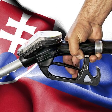 Gasoline consumption concept - Hand holding hose against flag of Slovakia