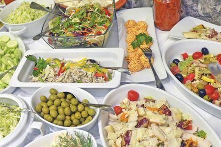 Variety of tasty and fresh food on table close up