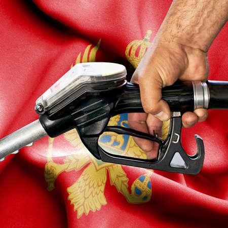 Gasoline consumption concept - Hand holding hose against flag of Montenegro