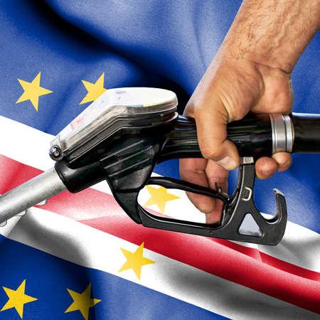 Gasoline consumption concept - Hand holding hose against flag of Cape Verde