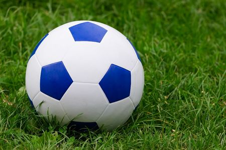 Soccer ball on green grass Stock Photo - 3370392