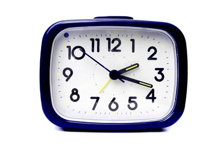 morning blue hour: Blue alarm clock on a white background