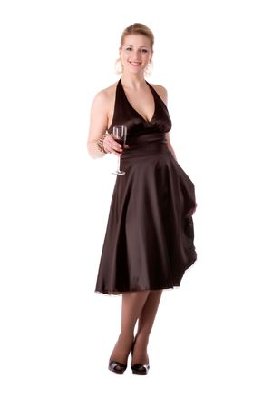 Woman in brown dress with a glass of wine on a white background photo