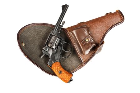 Old Soviet revolver on a white background photo