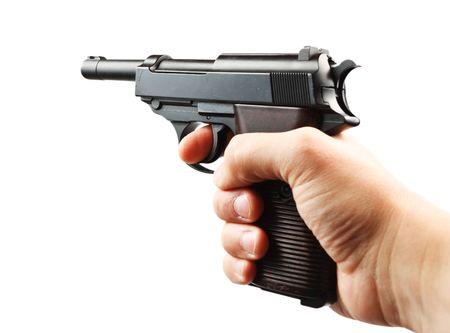 Old German gun in hand on a white background photo