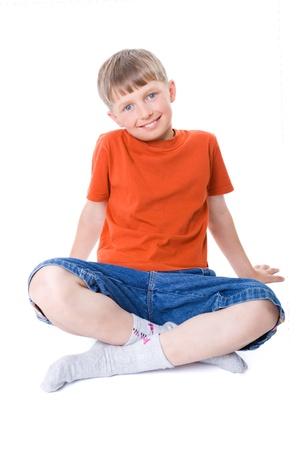 A boy sitting with legs crossed