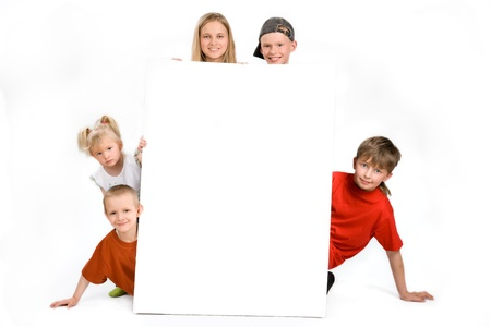 Group of children behind a blank sign, on a white background photo