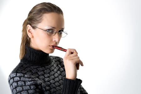 Portrait of a girl with pen photo