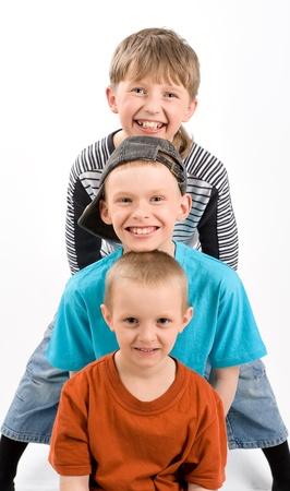 Three boys on white photo