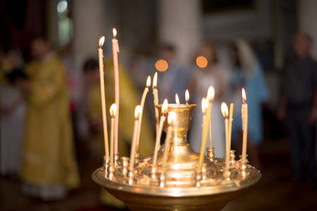 ambiance of church, candles and bokeh yellow lights.