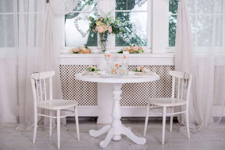 Dining table setting at Provence style, with candles, lavender, vintage crockery and cutlery, closeup