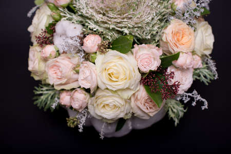 flower bouquet in a white pumpkin on a black background, a mixture of flowers, peony rose, eucalyptus, chrysanthemum, Brassica, white orchid, cotton.