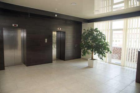 Two doors of elevators in modern business building.