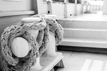 Mooring Bitts with white rope on the large ship, black and white photo. Stok Fotoğraf