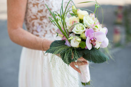 beautiful wedding bouquet in the hands of the bride Stock Photo