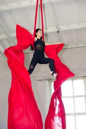 Speech gymnasts on the canvases. Girl on acrobatic canvases.Dangerous Circus Tricks.Aerial gymnast