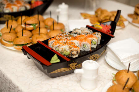 Sushi boat on table.Sushi boat on background of a burgs