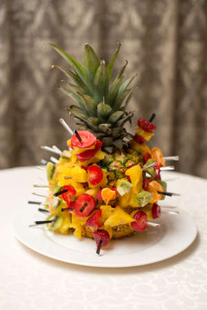 Fresh fruit salad served in bowls with fresh pineapple.