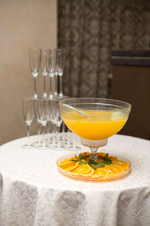 A pyramid of glasses. Orange Champagne with fruits. Stockfoto