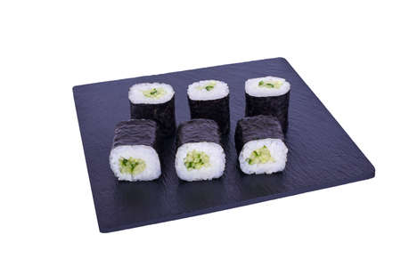 Traditional fresh japanese sushi maki on black stone Maki Capa on a white background. Roll ingredients: Cucumber, Nori, Rice. Stok Fotoğraf