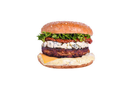 Fresh burger with chicken cutlet, dorblu cheese, sun-dried tomato, cheddar cheese, lettuce mix, dorblu sauce isolated on white background Foto de archivo