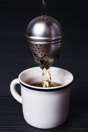 infuser: Infuser making tea
