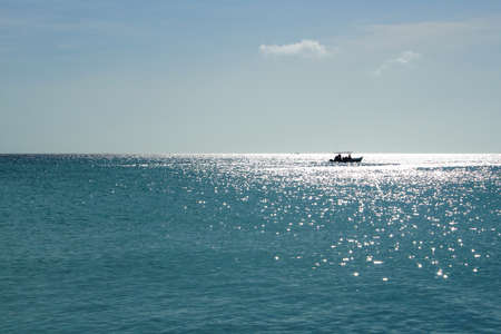 key of paradise: Boating under the sun on the beah