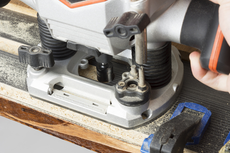 rabbet: Plunge router making a groove on wood Stock Photo
