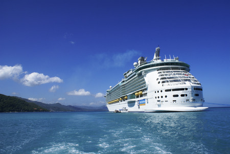 LABADEE, HAITI - OCTOBER 12, 2009:  Royal Caribbean Cruises, cruise ship Freedom of the seas anchored in Labadee. Labadee is a port located on the northern coast of Haiti. It is a private resort leased to Royal Caribbean Cruises. Stock Photo - 55124076