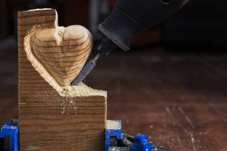 heart hard work: Carving wood in heart shape with rotary tool and cutter bit