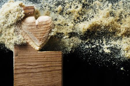 heart hard work: Flying sawdust over a wood heart