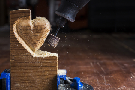 heart hard work: sanding wood in heart shape with a rotary tool