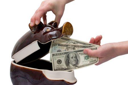 moneybox: man puts a money in money-box