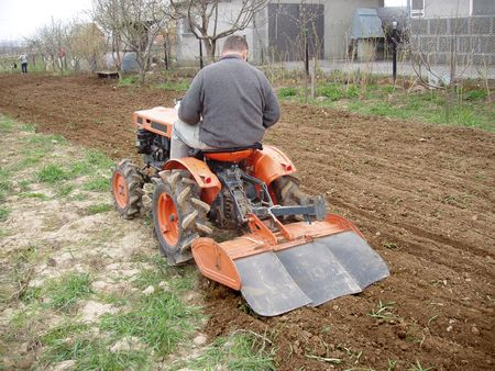 ripper: tractor prepares ground for planting Stock Photo