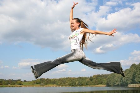 happy jumping girl on the water Stock Photo - 535258