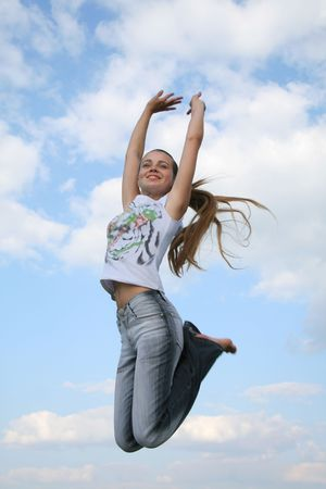 strenght: happy jumping girl in the sky