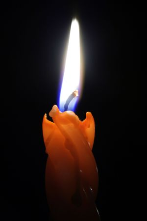 combust: light of candle in dark Stock Photo