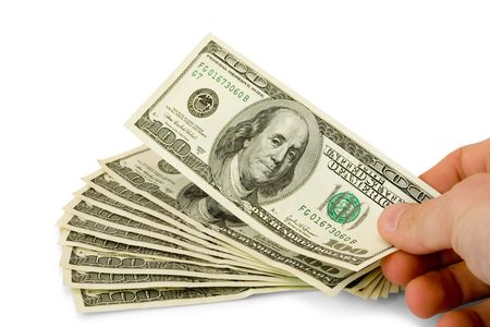 monies: sheaf of dollars with hand isolated on white (contains clipping path) Stock Photo