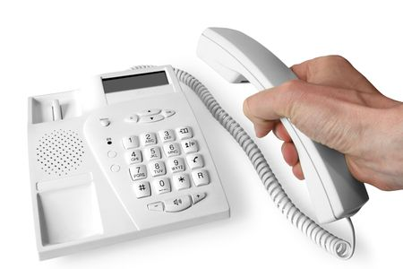 The hand holds telephone receiver above the phone photo