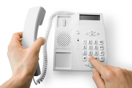 dialing the number on the phone (contains clipping path) Stock Photo