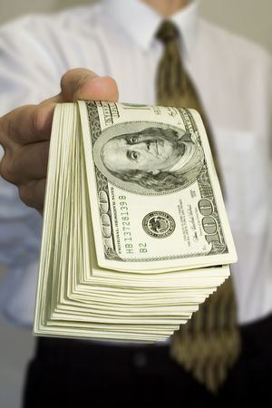 Money in the hand of the businessman photo
