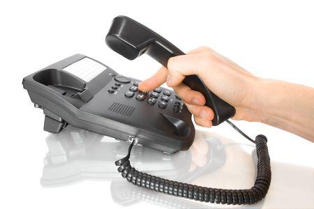 wijzerplaat: hand nummerkeuze op zakelijke telefoon Stockfoto