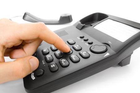 dialing: de marcaci�n. dedo de la mano y tel�fono de teclado